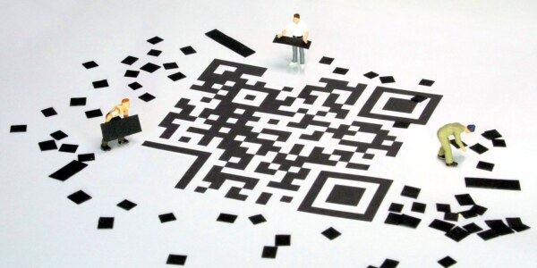 How do you scan a QR code on a computer?